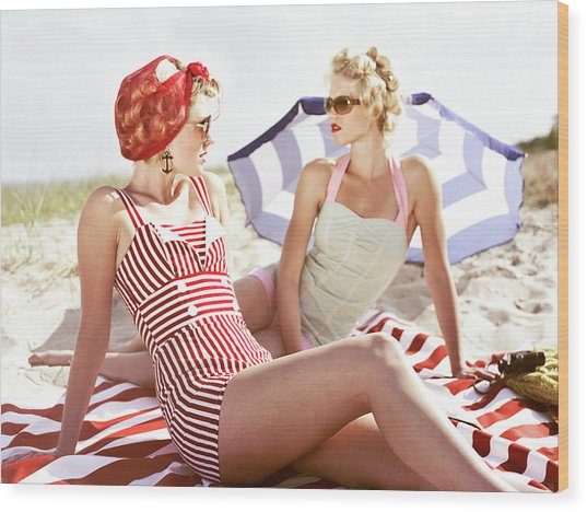 Two Retro Young Women On Beach Wood Print by Johner Images