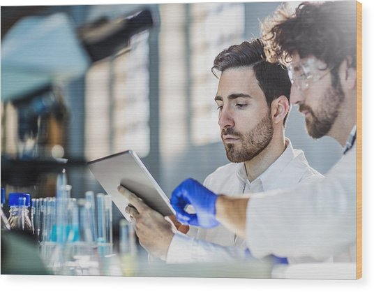 Two Scientist Using Digital Tablet In Laboratory Wood Print by Poba