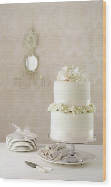 Two Tier Wedding Cake With Knife And Wood Print