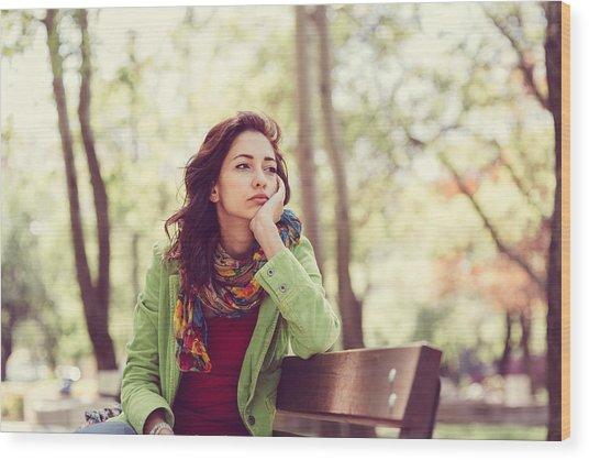 Unhappy Girl Sitting At Bench Wood Print by Martin Dimitrov