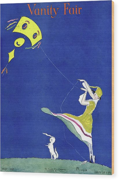 Vanity Fair Cover Featuring A Woman Flying A Kite Wood Print by Ethel Plummer