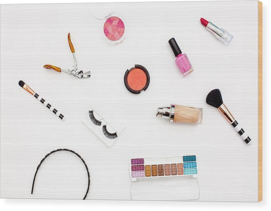 various makeup products and cosmetics in white background.Top view Wood Print by Carol Yepes