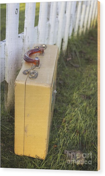 Vintage Luggage Left By A White Picket Fence Wood Print