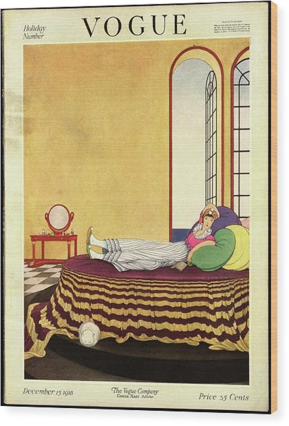 Vogue Cover Featuring A Woman Lying In Bed Wood Print