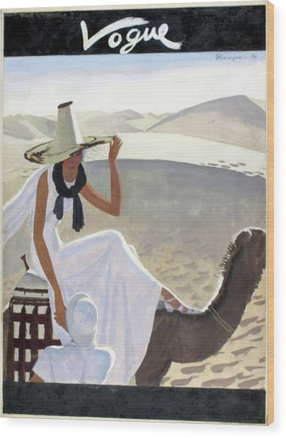 Vogue Cover Featuring A Woman Riding A Camel Wood Print by Pierre Mourgue