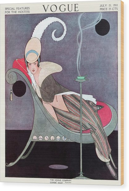 Vogue Cover Featuring A Woman Sitting In A Chair Wood Print by Helen Dryden