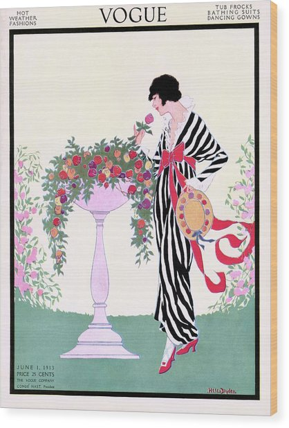 Vogue Cover Featuring A Woman Smelling A Rose Wood Print by Helen Dryden