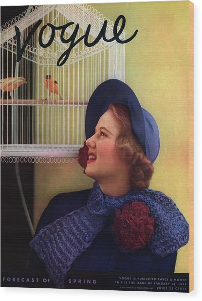 Vogue Cover Of Model Looking At Bird Cage Wood Print