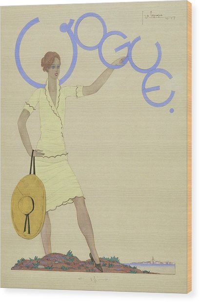 Vogue Magazine Cover Featuring A Woman Wearing Wood Print by Georges Lepape