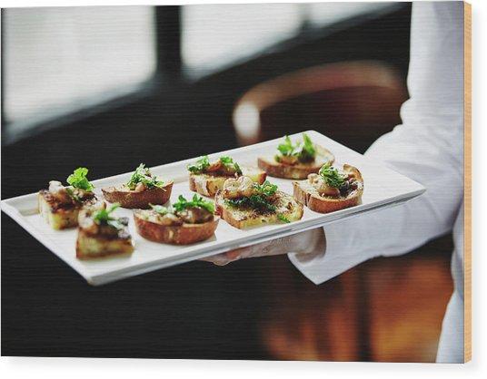 Waitress Holding Platter Of Organic Wood Print by Thomas Barwick