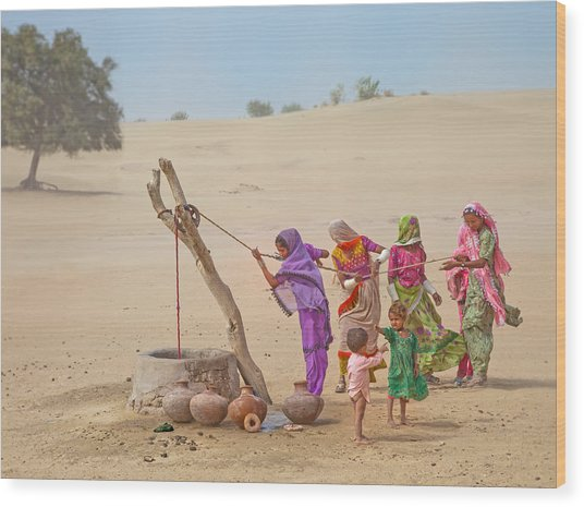 Water Pullers Wood Print by Sayyed Nayyer Reza
