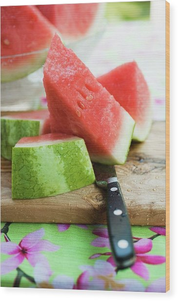 Watermelon, Cut Into Pieces, On A Wooden Board Wood Print