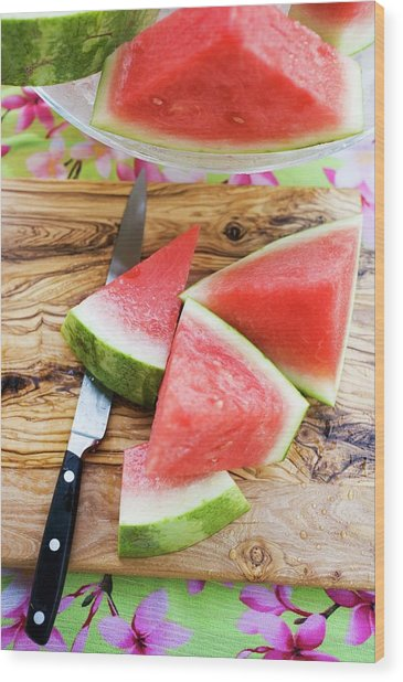 Wedges Of Watermelon And Knife On A Wooden Board Wood Print