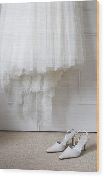 White Shoes On Floor Beneath Wedding Dress Hanging Outside Wardrobe Wood Print by Michael Blann