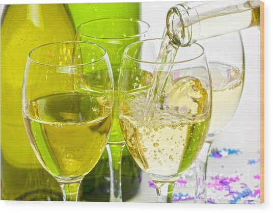 White Wine Pouring Into Glasses Wood Print by Colin and Linda McKie