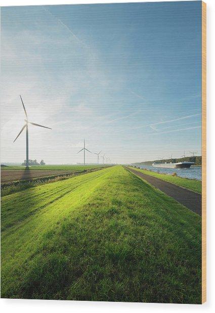 Wind Turbines And Canal, Bath, Zeeland Wood Print by Mischa Keijser