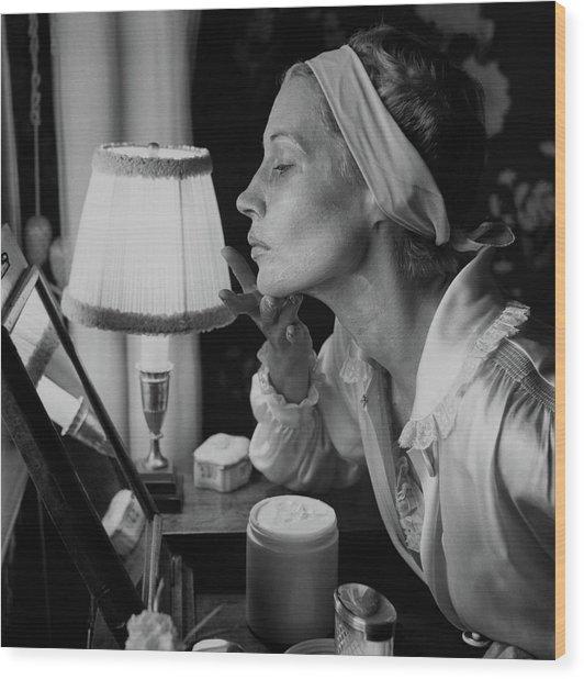 Woman Applying Face Cream Wood Print
