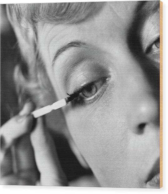 Woman Applying Mascara Wood Print