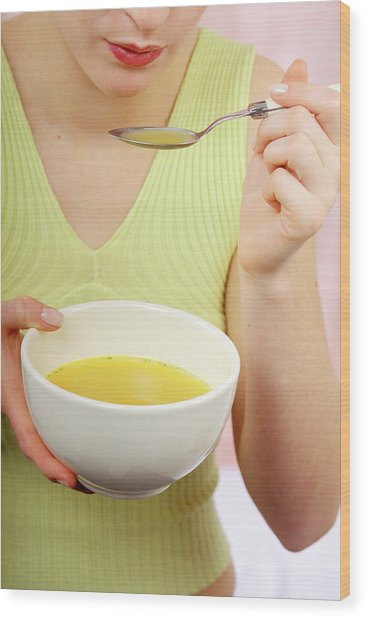 Woman Eating Soup Wood Print by Lea Paterson/science Photo Library