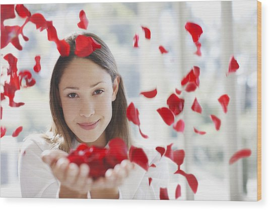Woman Holding Handful Of Flower Petals Wood Print by Tom Merton