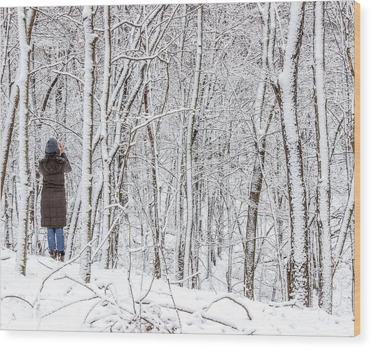 Woman In A Snow Covered Forest Wood Print