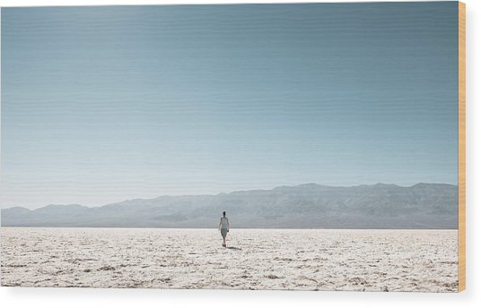 Woman On Field Against Clear Sky Wood Print by Christian Soldatke / EyeEm
