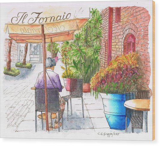 Woman Reading A Newspaper In Il Fornaio In Pasadena, California Wood Print