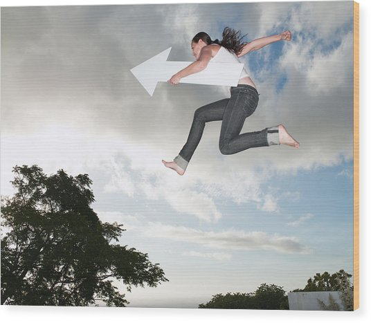 Woman With Blank Arrow Leaping Outdoors Wood Print by Robert Daly