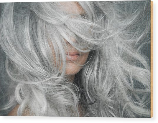 Woman With Grey Hair Blowing Across Her Face. Wood Print by Andreas Kuehn