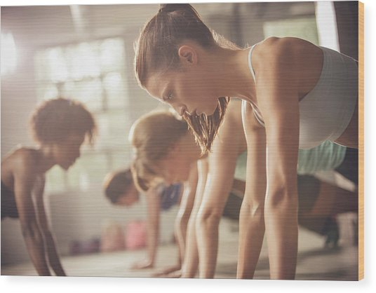 Women Working Out In Exercise Class Wood Print by John Fedele