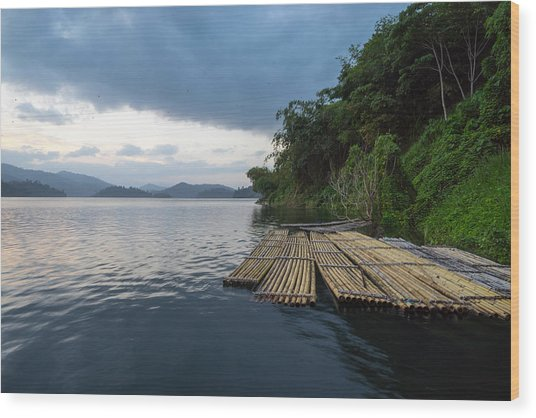 Wooden Rafts Moored On Lake By Trees Against Cloudy Sky Wood Print by Shaifulzamri Masri / EyeEm