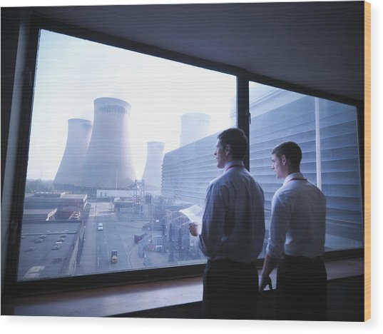Workers Looking Out Over Power Station Wood Print by Monty Rakusen