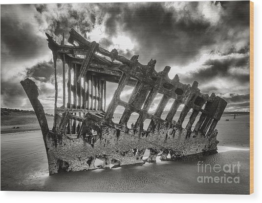 Wreck On The Shore Wood Print by Melody Watson