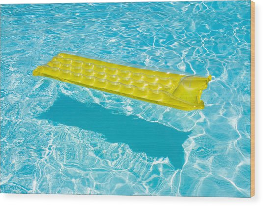 Yellow Raft Floating In A Pool Wood Print