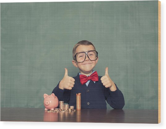 Young Boy Nerd Saves Money In His Piggy Bank Wood Print by RichVintage