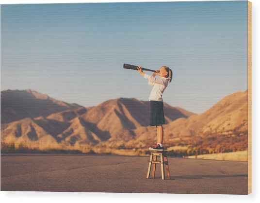 Young Business Girl Looks Through Telescope Wood Print by RichVintage