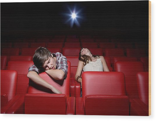 Young Couple Asleep In The Movie Theater Wood Print by Image Source