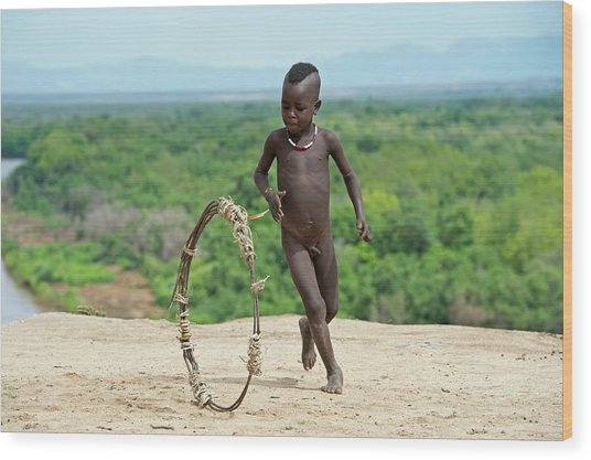 Young Karo Boy With Home Made Toy Hoop Wood Print