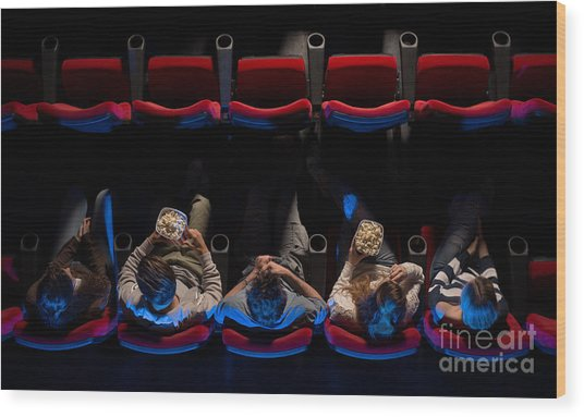 Young People Sitting At The Cinema Wood Print by Stock-asso