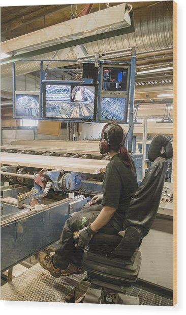 Young Woman Using Control Panel While Monitoring Computer Screens At Sawmill Wood Print by Hakan Jansson