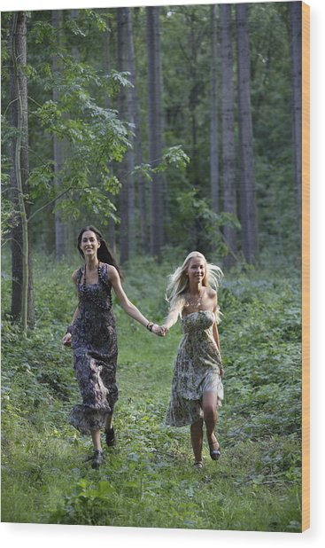 Young Women Running Through Forest Wood Print by Asia Images