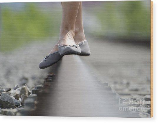 Balance On Railroad Tracks Wood Print