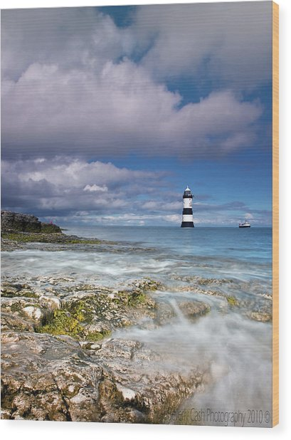 Fishing By The Lighthouse Wood Print