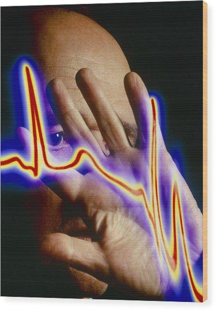 Heart Disease: Hand Held Up To Irregular Ecg Trace Wood Print by Mehau Kulyk