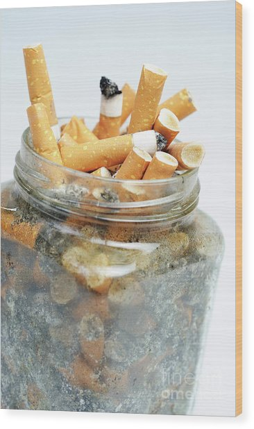 Jar Overflowing With Cigarette Butts Wood Print by Sami Sarkis