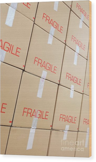 Stacks Of Cardboard Boxes Marked 'fragile' Wood Print by Sami Sarkis