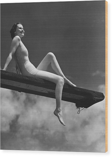 Woman Sitting On Divingboard Wood Print by George Marks