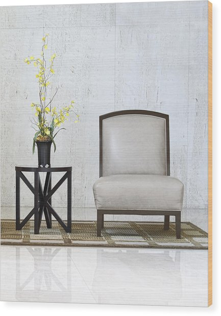 A Chair And A Table With A Plant  Wood Print