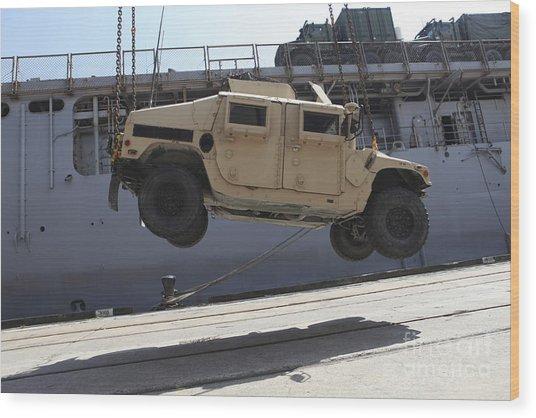 A Crane Lifts An M998 Humvee Wood Print