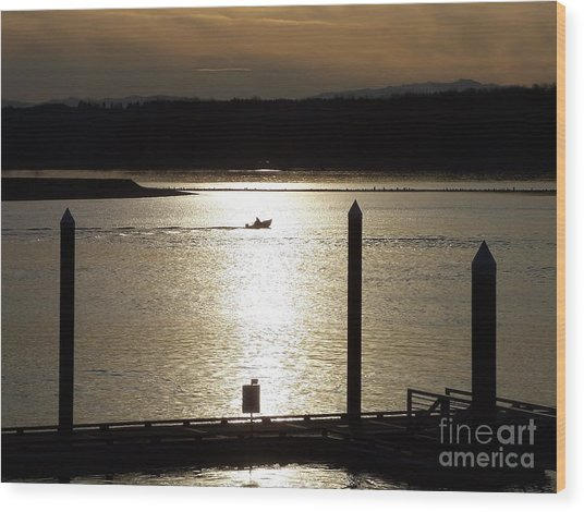 A Lone Boat At Sunset Wood Print